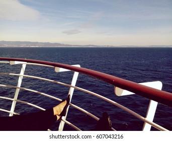 Passengers enjoying a trip on big cruise ship. Photo in vintage style.