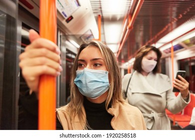 Passengers with face masks because of the Covid-19 pandemic in local public transport