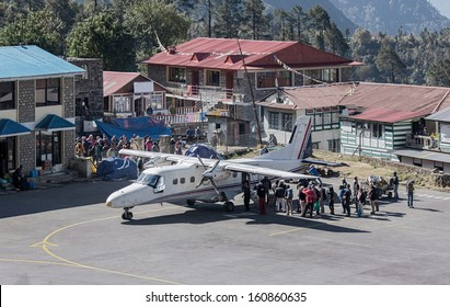 Passengers go on the plane in the Tenzing-Hillary airport Lukla - Nepal, Himalayas