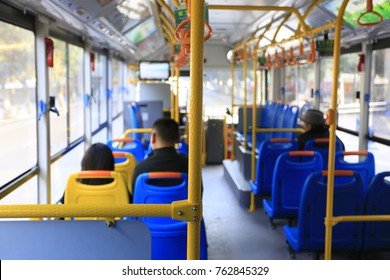 The passengers are inside the bus