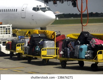Passengers luggage loading in to the airplane