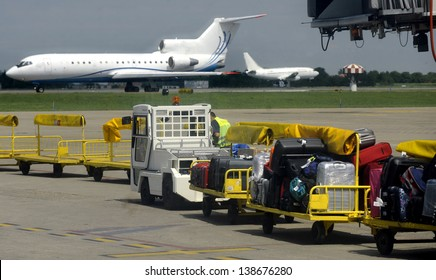Passengers luggage loading in to the plane