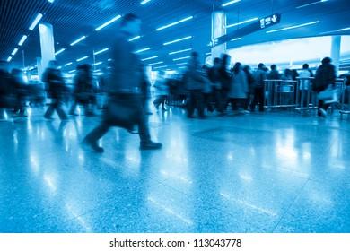 passengers motion blur in shanghai subway transfer center