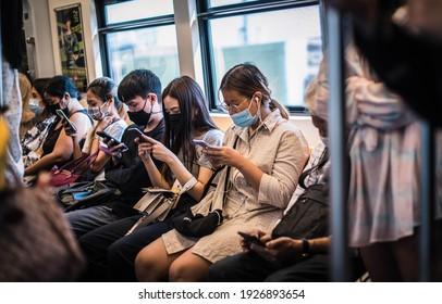 Passengers on the BTS skytrain wear surgical masks, Bangkok, Thailand, February 25, 2021.