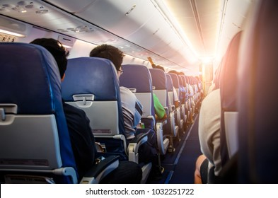 Passengers on commercial aircraft or plane that air transport is the current popular and fast with lighting.