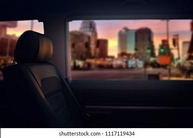 Passengers seats and window of comfortable luxury van. VIP class shuttle van at the evening city