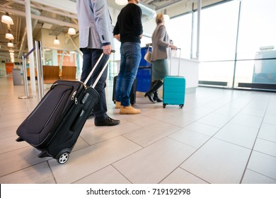 Passengers Standing On Floor With Baggage At Airport Reception A