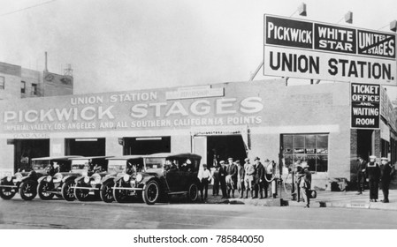 Passengers wait for a 'Pickwick Stage' at Charles Wren's Union Station in Los Angeles, 1920. Pickwick stages, started out with touring cars in 1911, which by 1920 had elongated into bus like vehicles