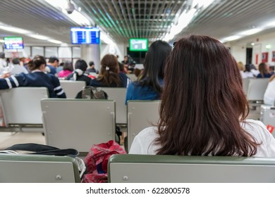Passengers waiting the airplance arrive at the seat in the airport. transportation concept