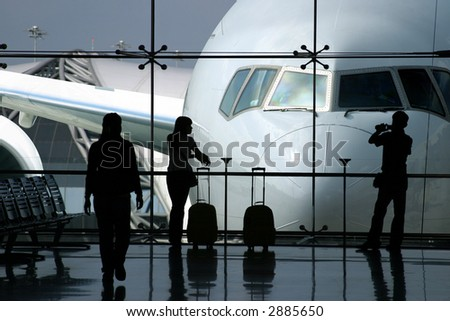 Passengers waiting for the airplane in the airport