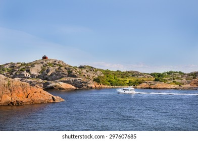 A passing boat through the rocks in Larvik