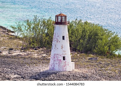 Passing Hog Island Lighthouse on Paradise Point, Port of Nassau, The Bahamas from above with focus on top, views of the unprotected Ocean side showing the distressed condition after Hurricane Dorian.
