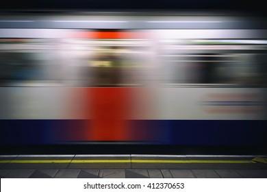 Passing train on the London tube platform.