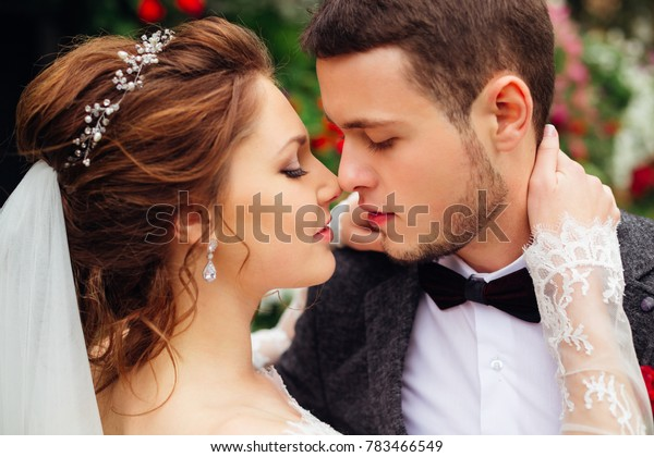 the passion between the magnificent bride and the elegant groom who are want to kiss