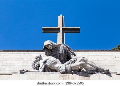 The passion of Christ statue and the big cross on the top of the Valley of the Fallen (Valle de Los Caidos), the burying place of the Dictator Franco on the Sierra the Guadarrama, Madrid, Spain
