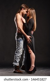 Passion couple in love on dark bacjground