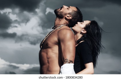 Passion couple in love. Romantic moment of sensual lovers. Handsome muscular guy and amazing sexy girl. Kissing and flirt