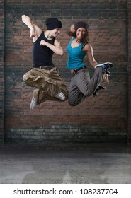 Passion dance couple jumping.