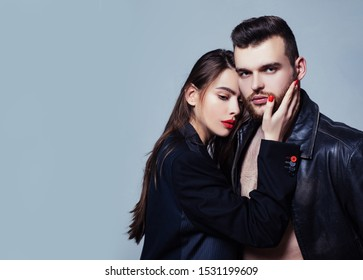 Passion fashion. Couple passionate people in love. Man brutal well groomed macho and attractive feminine girl long hair cuddling. Girlfriend passionate red lips and man leather jacket. Passionate hug.