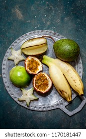 Passion fruit, bananas, carom on a metal plate