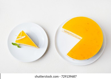 Passion fruit cake, mousse dessert on a white plate. Top view.