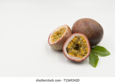 Passion Fruit, Fresh Passion Fruit with leaves on white background, Cross-section of a purple passion fruit, Tropical fruit, Collection of whole and cut passion fruits (maracuya) isolated.