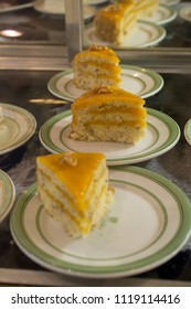 Passion fruit (Maracuja) cake, a tasty Brazilian dessert made viewed through the glass of a bakery