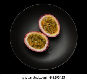Passion fruit / maracuja isolated on black background