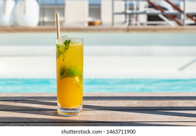 Passion fruit Mojito at swimming pool on cruise vacation. Alcoholic summer cocktail.