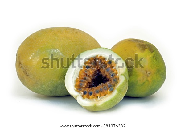 Passion fruit, Passiflora edulis, fruit originating in Americas and greatly appreciated and cultivated in Brazil, on white background
