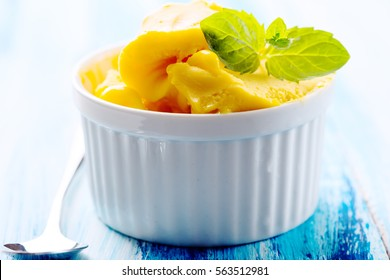 Passion fruit sherbet with mint leaves