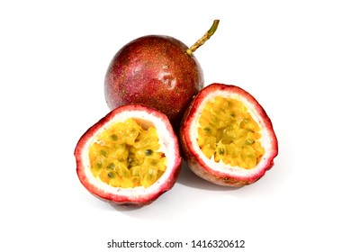 Passion fruits isolated on white background. Whole and cut tropical fruits.