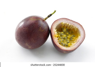 .Passion fruits with pulp spilling, isolated on white