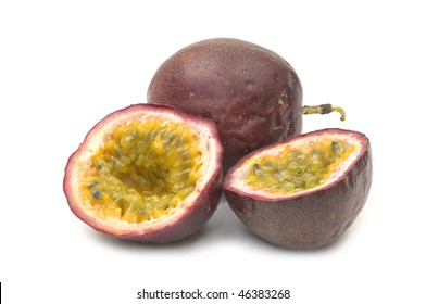 Passion fruits with pulp spilling, isolated on white