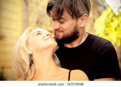 Passion hugs of loving couple in the ancient European city. (Romance, love, family, marriage concept)