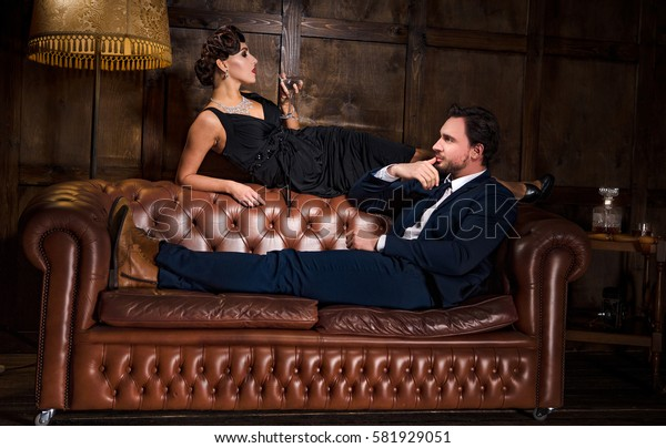 Passion, relations concept. Rich businessman ready to have elegant woman with red lips. Wealth, luxury concept. Romantic atmosphere.
