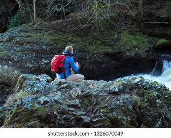 Passionate about the waterfall.  Alyth, Blairgowrie, Scotland - February 15, 2019 An amateur photographer captures the beauty of nature at the Reekie Linn waterfall in Scotland.
