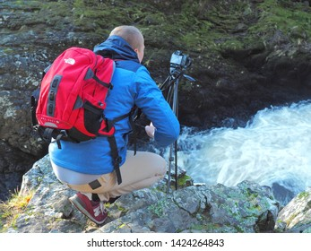 Passionate about the waterfall.  Alyth, Blairgowrie, Scotland - February 15, 2019 An amateur photographer captures the beauty of nature over the Reekie Linn waterfall in Scotland.
