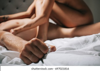 Passionate beautiful couple in bedroom enjoying foreplay. Lifestyle. Beautiful couple in bed. Romantic young couple in bed at home. Orgasm concept. Sexy erotic photo. Adult concept. Sexuality. Sexual