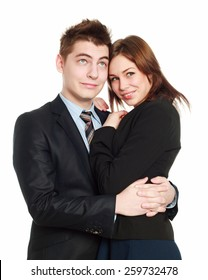 Passionate business couple embracing each other and looking dreamily up, isolate on a white background