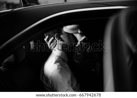 Passionate couple in the back seat of a car