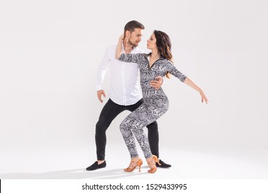 Passionate couple dancing social danse kizomba or bachata or semba or taraxia on white background with copy space