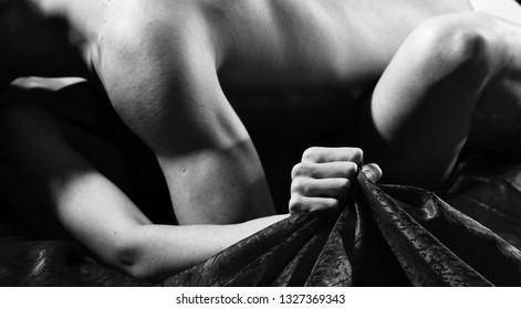 Passionate couple have sex make love. Female orgasm. Sex and pleasure concept. Feeling of intense sexual pleasure. Hand squeeze bedclothes. Moaning in sex ecstasy. Naked lovers passionate sex.