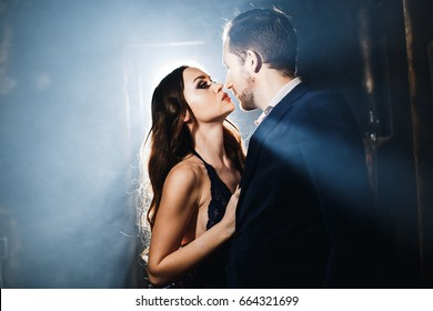 Passionate couple kisses, boy and girl, stand facing each other