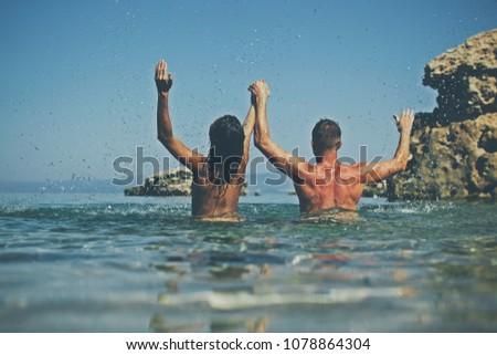 People having sex in the water