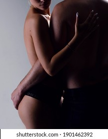 A passionate couple in love. The hand of a man embrace the sexy buttocks of a woman