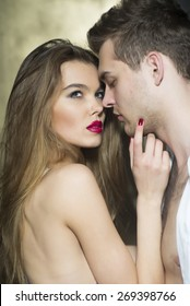 Passionate couple of lovers standing out to embrace, vertical picture