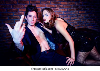 Passionate couple making love. Beauty, fashion. Nightlife concept, party.