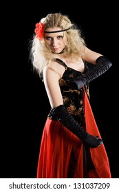 Passionate, emotional young girl dancing classical spanish dance.