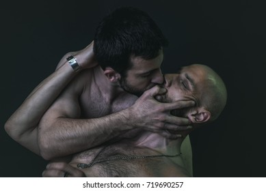 Passionate gay kiss and embrace